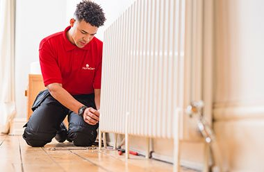 HomeServe approved Gas Safe Registered Engineer fixing radiator