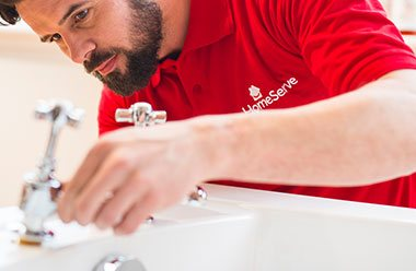HomeServe approved Plumber fixing a tap